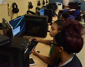 SmurfAttack_1.5's Mia Speights, Shayla Terry, and Kylah Williams compete in the Girls Go CyberStart National Championships