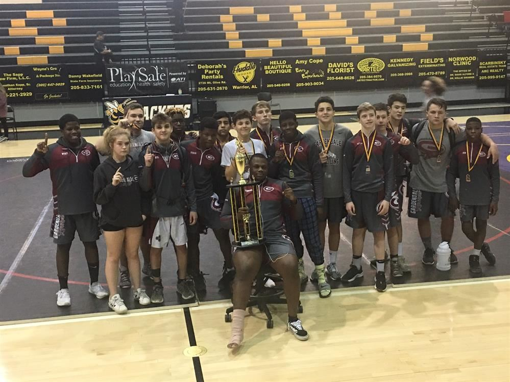 Image of Wrestling Team with trophy.