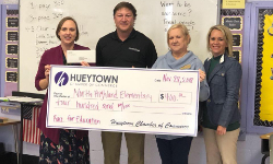 Hueytown Chamber of Commerce presents Mrs. Cruz a check.