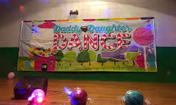image of candy themed banner saying daddy daughter dance