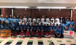 group photo of students, faculty and staff with kids mercedes marathon shirts on