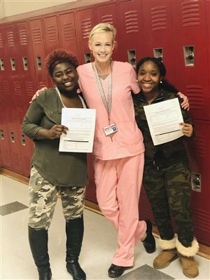 Students Shun Williams and Taniya Eubanks pictured with Mrs. Daniel