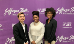 Students pictured in front of Jefferson State Community College Backdrop